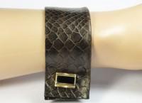 Nice Manchette en cuir façon reptile et bouton doré et onyx